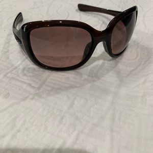 Women's dark brown Oakley sunglasses